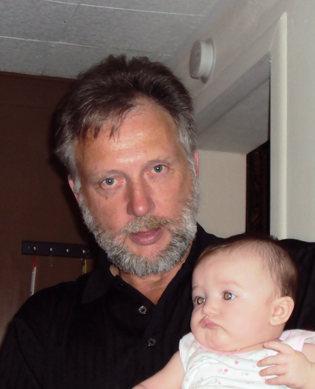 The author of this blog holding a baby girl.